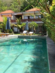 The swimming pool at or near Crystal Bay Bungalows
