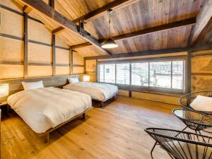 A bed or beds in a room at EN Takeda Castle Town Hotel