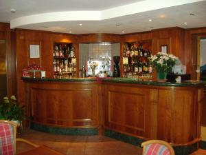 The lounge or bar area at Hotel Edelweiss