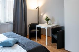 Кровать или кровати в номере Hotel Birkenstern
