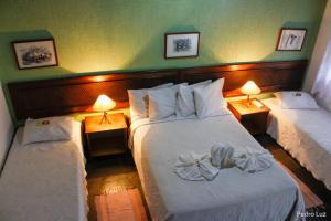 A bed or beds in a room at Hotel Vilar Formoso