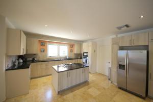 A kitchen or kitchenette at Opal Villa