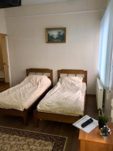 A bed or beds in a room at Гостевой дом Салонка