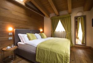Letto o letti in una camera di Sottovento Luxury Hospitality