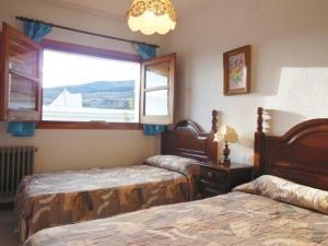 Cama o camas de una habitación en Apartamentos Rurales Panjuila