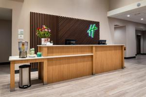 The lobby or reception area at Holiday Inn & Suites Orlando International Drive South