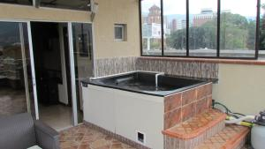 A kitchen or kitchenette at Apartamentos en el Poblado
