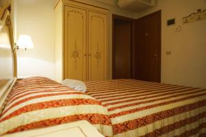 A bed or beds in a room at Guesthouse Al Profeta
