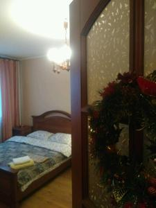 A bed or beds in a room at Аппартаменты на Останкинской