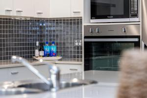 A kitchen or kitchenette at Beachfront One, Mollymook