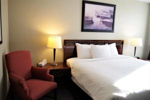 A bed or beds in a room at The City Motel