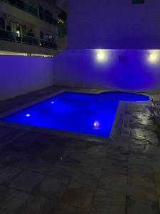 The swimming pool at or near Apartamento Praia Grande