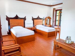 A bed or beds in a room at Myanmar Beauty Hotel 2