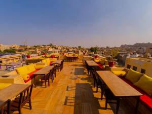 A restaurant or other place to eat at Hotel Pleasant Haveli - Only Adults