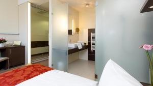 Кровать или кровати в номере EnergieHotel Berlin City West