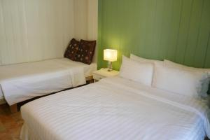 A bed or beds in a room at Banpu Koh Chang Resort