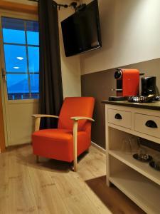 Телевизор и/или развлекательный центр в Flåm Marina