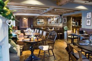 A restaurant or other place to eat at The Legh Arms Prestbury