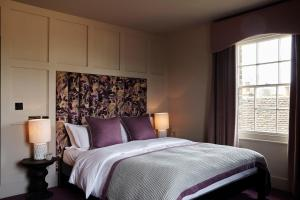 A bed or beds in a room at Hertford House