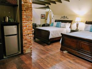 A bed or beds in a room at Chelsea Pub and Inn