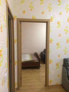 Кровать или кровати в номере Дмитров посуточно