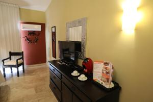 A television and/or entertainment center at Hotel Montetaxco