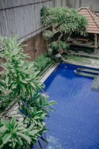 The swimming pool at or close to Wiras Village