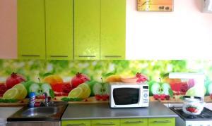 A kitchen or kitchenette at Херсонская 38