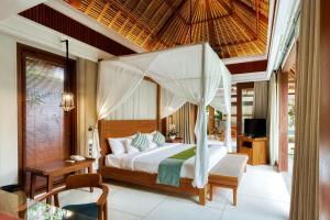Letto o letti in una camera di Regali Villa Canggu