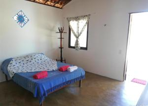 A bed or beds in a room at Lagoa dos Coqueiros