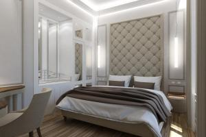 A bed or beds in a room at Hotel Pierre
