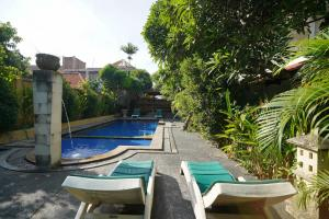 The swimming pool at or close to OYO 2122 Puri Sanur
