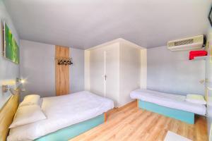 Un ou plusieurs lits dans un hébergement de l'établissement Fasthotel Macon Nord