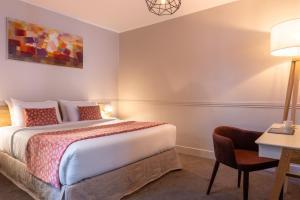 Cama ou camas em um quarto em Hotel 29 Lepic