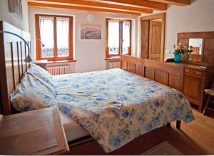 Ein Bett oder Betten in einem Zimmer der Unterkunft Bus De l'Och