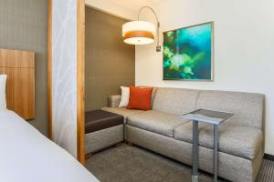 A seating area at Hyatt Place San Jose, Downtown