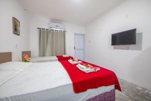 A bed or beds in a room at Flats Gol de Placa