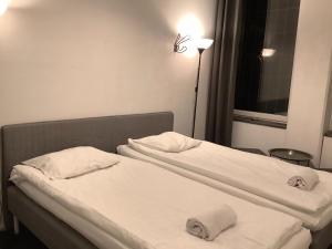 Säng eller sängar i ett rum på Acco Hostel