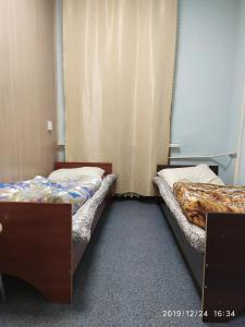 A bed or beds in a room at Подушка