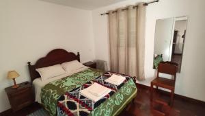 Un ou plusieurs lits dans un hébergement de l'établissement Ilha & Montanha - Turismo Rural
