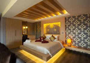 A bed or beds in a room at Sita Beach Resort