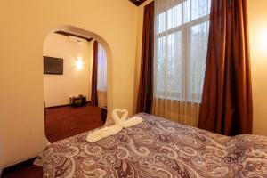 Кровать или кровати в номере Гостиница Четыре Комнаты