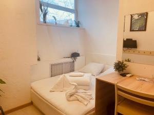 Кровать или кровати в номере Капсульный Отель Интеркуб Третьяковская