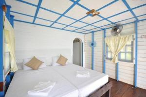 A bed or beds in a room at Amaresa Resort & Sky Bar - experience nature