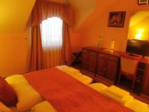 Postel nebo postele na pokoji v ubytování River Star Hotel
