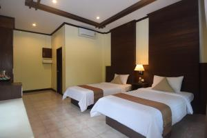 A bed or beds in a room at Clean Beach Resort