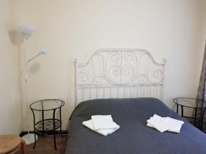 Кровать или кровати в номере Hotel Dom tvorchestva imeni D.N. Kardovskogo