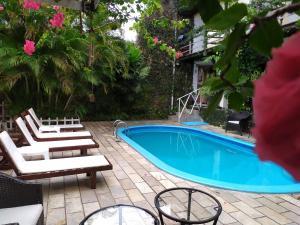 A piscina localizada em Pousada Beijos y Abraços ou nos arredores