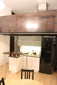Kuchyň nebo kuchyňský kout v ubytování Lupus Apartment No. 2