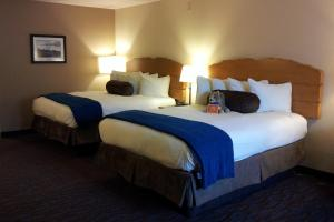A bed or beds in a room at The Lexington at Jackson Hole